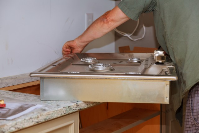 plumber putting in sink Plumbers Network
